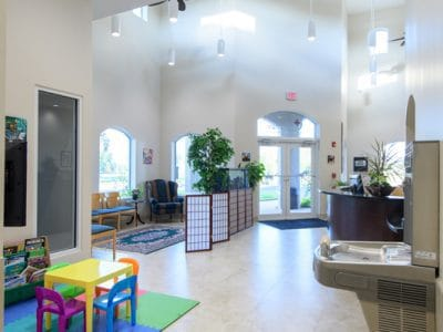 The waiting area of Guardian Veterinary Medical Center. This includes a special play area for children who area waiting